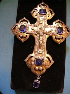 Roman Catholic pectoral cross made of gold, with precious stones.