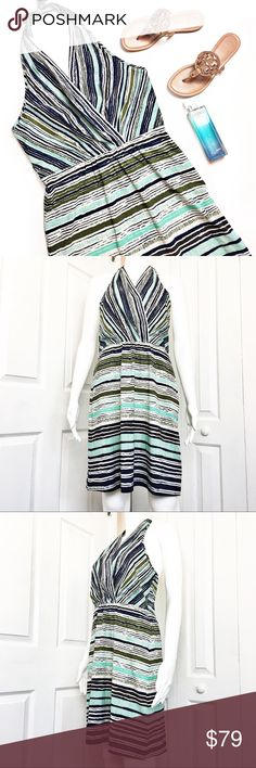 """Athleta Go Anywhere Halter Dress This is an adorable dress by Athleta.  Multi-blue stripe halter style, v-cut neckline with side zip and eye hook closure.  50+ UV protection.  Excellent condition. Material tag has been listed.  Measurements laid flat: Bust: Difficult to measure due to halter style Waist: 16"""" Hip:  21"""" Length from top of bust to hem: 33"""" *Measurements are approximate. Athleta Dresses"""