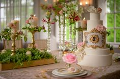 Tie your wedding theme into your cake, like this enchanted garden design complete with a gilded frog.