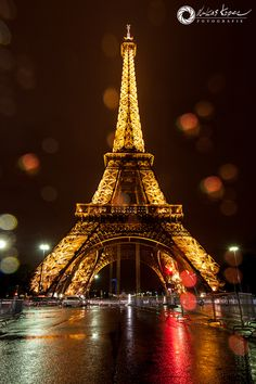 Rainy night in Paris at the Eiffel Tower