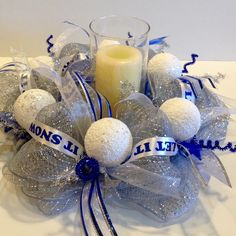 "Christmas ""Let it Snow"" blue, silver and white 15"" round deco mesh candle ring with stars and snowball ornament accents."