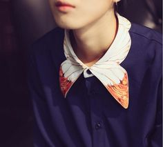 FineArt Collection.  Dark blue shirt with butterfly collar, the collar part is designed as butterfly wings, the orange color brights with the dark blue base. The sleeves are designed as vintage lantern style, not very exaggerate way puffy but elegant way. The cuff part is simple white correspon...