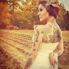 she's so beautiful. I hope I look this amazing in a wedding dress with my tattoos.