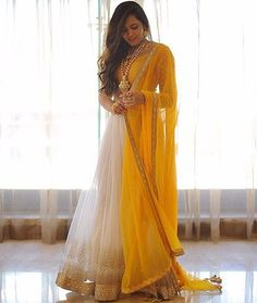 Buy Yellow & White Solid Net Lehenga Choli online in India at best price.Deck yourself up in this yellow - white lehenga choli. Lehenga Designs, Indian Wedding Outfits, Indian Outfits, Dress Wedding, Hair Wedding, Wedding Sarees, Emo Outfits, White Outfits, Indian Attire