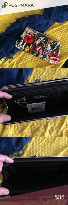 Vera Bradley clutch/wallet NWT Vera Bradley clutch or wallet. Perfect if you need to add a pop of color to an outfit. It measures 4 1/2 in. high and 9 in. at its widest point. Vera Bradley Bags Wallets