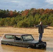 Up a creek without a paddle. International Scout II in a little puddle.