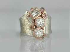 Diamond Jewelry We'll customize our signature designs to suit your heirloom diamonds. This white and pink diamond ring was set with recycled heirloom diamonds. Pink Diamond Ring, Diamond Jewelry, Silver Jewelry, Vintage Jewelry, Fine Jewelry, Unique Jewelry, Men's Jewelry, Handmade Jewelry, Jewellery Shops
