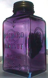 Love the purple! Beautiful antique purple glass jar, all-original with brass cap. This is a very early hand Blown In Mold jar with a hand finished lip, dating it back a good 100 years or so.