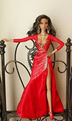FR  Rising  Sun  Kyori  is  wearing  a  gown  originally  belong  to 2011  Reba  McEntire  barbie  doll.  The  red  gown  was  inspired  by Rebas  famous  song  FANCY.