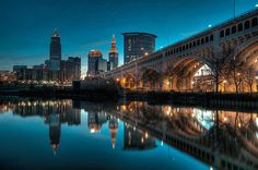 Reflections on the Cuyahoga - The skyline of the city of Cleveland, Ohio and the Veterans Memorial Bridge reflected in the Cuyahoga River. Brandywine Falls, Pass Photo, Cincinnati Skyline, Ohio Stadium, Cleveland Ohio, Cleveland Rocks, Lighthouse Photos, Forest City, Ohio River