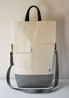 Chester Wallace of Portland. His totes are hand cut and sewn!! Love.