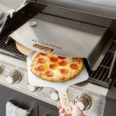 Convert your gas grill into a pizza oven and create pies that rival their pizzeria counterparts. The Gas Pro creates a cooking chamber that focuses heat to cook, crisp and brown pizzas to perfection. Outdoor Pizza Oven Kits, Pizza Oven For Grill, Pizza Kit, Best Homemade Pizza, Four A Pizza, Grilled Pizza, Grill Accessories, Barbecue Grill, Crate And Barrel