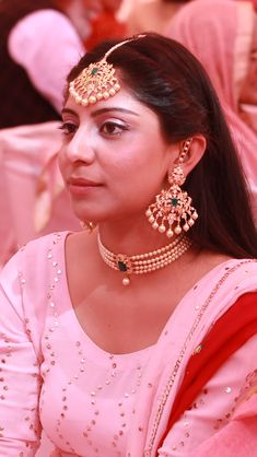 Emerald gold and pearl earrings choker and tikka