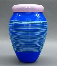 "A Mary Ann Toots Zynsky Blown Glass ""Chiacchiera"" Vase for Venini. She's studied with Dale Chihuly, and participated in the founding and early development of the Pilchuck Glass School. In 1984 she was invited to Venini Glassworks.  This incamiciato glass vessel consists of a thick puce colored rim above a vibrant Cobalt blue body that is decorated with applied bright green threading. Signed ""Zynsky Venini '95"". Minor wear, polished pontil, engraved signature with label. ESTIMATE $1,000-2,000"