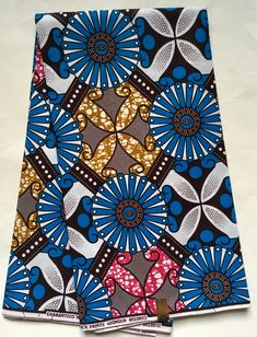 House of Mami Wata African Print Fabrics https://www.etsy.com/listing/585284691/african-print-fabric-ankara-blue-fuschia