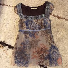 Anthropologie Top By Weston Wear. Really pretty, lined, sheer top with gorgeous flower details around the neckline. Gathered cap sleeves. Ties in the back. 100% nylon. GUC Anthropologie Tops