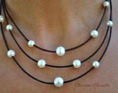 This beautiful Pearl and Leather Lariat necklace goes perfect with any wardrobe choice. There are 5 AAA quality 11mm rice pearls on fine quality metallic gold leather. It also is available in many leather colors.  There are 2 choices in style: (Let me know in comments when ordering.) 1. A fixed length with a 12mm pearl button clasp making the necklace part hang 18 inches while the Lariat parts hang to 2 3/4 more inches. 2. Two sliding pearl knots giving you a variety of lengths being short…
