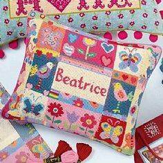 £59.99 Butterflies Name Cushion Tapestry Kit  Personalise you own cushion with this Jolly Red tapestry kit. Makes a tapestry panel approx. 40cm x 33cm in tent or half cross stitch.
