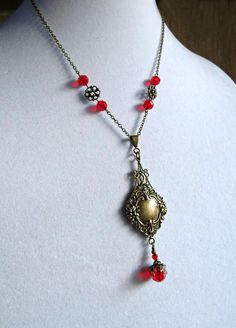 Check out this item in my Etsy shop https://www.etsy.com/listing/560320474/brass-victorian-necklace-red-crystal