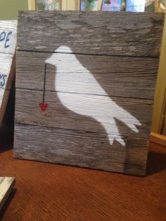 Dove with heart painted on old barn wood