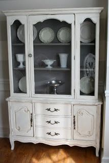 Love this french provincial cabinet-----I'd paint the inside green.