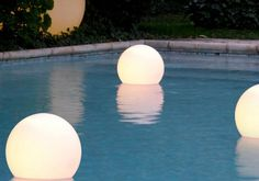 I want these!! Pool lights that float in your pool. Great for summer evenings, pool parties etc.