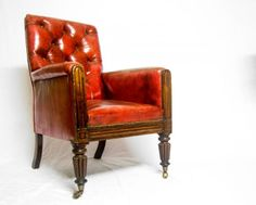 GEORGE IV OAK LIBRARY CHAIR WITH BUTTONED BACK, ARMS & SEAT IN RED LEATHER ON TURNED REEDED LEGS & CASTORS. - Stock - Antiques Young Guns