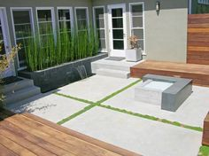 Google Image Result for http://images.landscapingnetwork.com/pictures/images/500x500Max/walkway-and-path_4/modern-concrete-patio-fire-feature-dc-west-construction-inc_4489.jpg