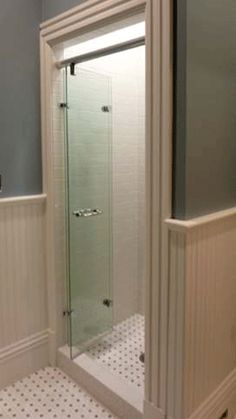 Wilson Glass BI-FOLD SHOWER: Glass door has swiveling, rolling hardware for a smoothly operating door system that has no curbs (no vinyl, no caulk, no mildew); door folds open for full access to bath, and closes flush, no leaks. Marine grade stainless steel, seamless movement. Made in Berkeley, CA, USA.