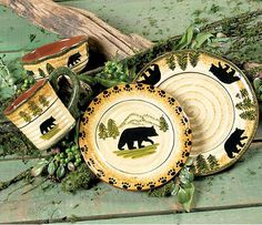 Black Forest Dinnerware Collection ~  A hand-painted bear and pine tree design makes the textured stoneware Black Bear Forest Dinnerware Set a welcome addition to your rustic table. Microwave, oven and dishwasher-safe.