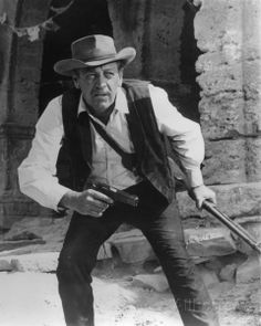THE WILD BUNCH - William Holden as 'Pike Bishop' is prepared for the final shoot-out with Mexican soldiers - Directed by Sam Peckinpah - Warner Bros. Best Movies List, Good Movies, Sam Peckinpah, The Wild Bunch, Cinema, New West, Great Western, Tough Guy, Western Movies