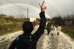 Refugees walking outside a camp near the Turkish-Syrian border