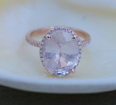 Engagement ring by Eidelprecious.  This engagement ring features really impressive peach sapphire. It is a 6.07ct unheated light peach champagne beauty, SI/I clarity. The setting 14k rose gold setting with SI/H diamonds, TDW 0.25ct  This setting is compatible with a rose gold diamond wedding band and would look awesome together. Sz 6, can be resized  Thanks for looking :)  Details: Main Stones Origin: Natural, not created Clarity SI/I  Accented Stones: Natural Diamonds Carat W...