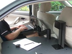 Laptop arm being used in a Toyota Camry.GoErgo.com