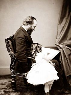 President James A. Garfield & daughter.  It was created between 1860 and 1865.