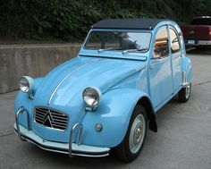 Citroen 2CV....my mom drive one of these back in the day. it was apple green :) love this car!
