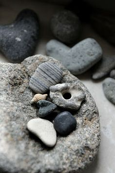 Beach stones - It is said that a stone with a hole through it brings good luck to the person that carries it.  But, it must be found, not looked for, not bought nor gifted.