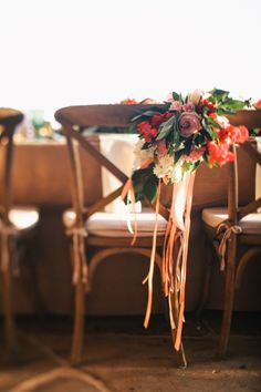 Floral garland with ribbons for the couple's chairs..  Read more - http://www.stylemepretty.com/2013/10/29/malibu-wedding-from-max-wanger-bash-please/