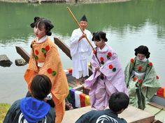 Boys with their hair dressed in the heian era juvenile style arriving at a KyokusuI No En poetry party .