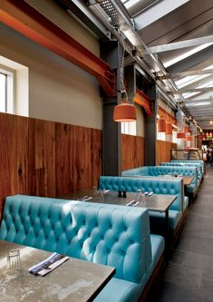 Jamie's Italian Restaurant Interior Design | Sky Blue Tufted Booths in Modern Industrial Space