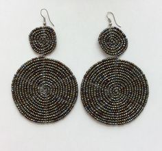 These+earrings+are+handmade+by+Masai+craftswomen+in+Kajiado+County,+Kenya.+Although+the+earrings+are+crafted+using+traditional+techniques,+the+designs+are+distinctly+modern,+so+they+complement+your+casual+and+formal+looks+beautifully.+These+two+disc+earrings+measure+3.5+by+2+inches,+and+are+the+p...