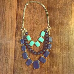 """Layered necklace Layered necklace purchased from local boutique, worn once. Gold chain, blue stones and beads. Mint, navy, royal blue from top to bottom. Full length is approximately 11.5"""". Jewelry Necklaces"""