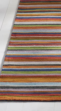 Our Linea Rug earns its stripes. Skilled weavers use only space-dyed wool to create a rug with greater depth and color.