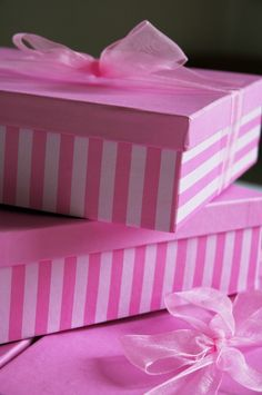 Use pink tape to turn a plain white box into a striped one. You can paint the top or leave it as is then tie it all up with a pretty pink ribbon. #giftwrap