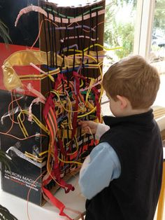 The progression of the children'x weaving and wool interests stemed from this group weaving project