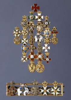 Frederik VII's miniature orders. The 27 orders are all in silver, but otherwise made as accurate copies of the original badges. Military Inspired Fashion, Military Awards, Military Decorations, Military Orders, Military Insignia, Royal Jewelry, Chivalry, Coat Of Arms, Military Ribbons