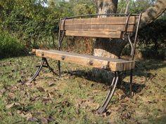 Bench, reclaimed oak, forged steel.