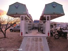 Multiple roof top tents mounted on motorcycle trailer.