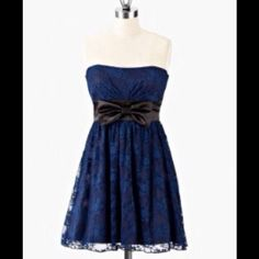 Navy blue and black strapless lacy dress Black and navy blue strapless lace dress, perfect for homecoming, a party or event. Dresses