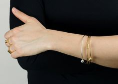Stacking/layered looked. Rings and bangles.
